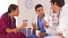 Hispanic doctors talking on their coffee break Stock Footage