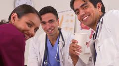 Happy Mexican doctors taking their coffee break Stock Footage