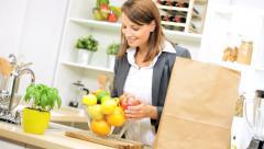 Business Female Unpacking Shopping Bag Fruit Stock Footage