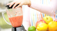 Hands Young Female Using Blender Organic Fruit Drink - stock footage