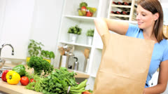 Caucasian Female Unpacking Shopping Bag Vegetables Stock Footage