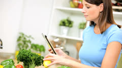 Caucasian Female Using Wireless Tablet Home Kitchen Stock Footage