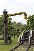 steam train locomotive engine water crane column standpipe spout - stock photo