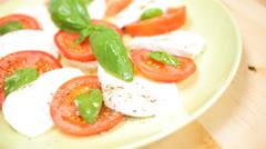 Close Up Buffalo Mozzarella Tomato Basil Salad Stock Footage