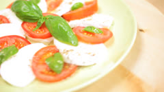 Fresh Buffalo Mozzarella Tomato Basil Salad Close Up  Stock Footage