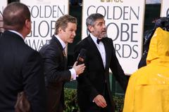 George clooney and billy bush.67th golden globe awards rainy day.held at the  Stock Photos