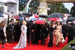 patricia arquette and thomas jane.67th golden globe awards rainy day.held at  - stock photo