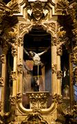 Crucified jesus hanging from cross altar valencia church mexico Stock Photos