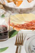 Typical spanish tapa with slices of serrano ham and manchego cheese, accompan Stock Photos