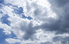 Fluffy cloudy blue sky scape 011 - stock photo
