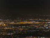 Stock Video Footage of 2K 24p -  Phoenix Sky Harbor airport by night overview from mountain top