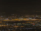 Stock Video Footage of 4K 24p -  Phoenix Sky Harbor airport by night overview from mountain top