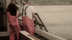 Lobster fishermen pulling up their trap Stock Footage