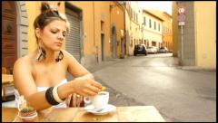 Yong beautiful woman sweeten  coffee in italian outdoor cafe - stock footage