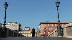 Priest walks over Rome bridge Stock Footage