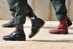 Army boots stand out in a crowd Stock Photos