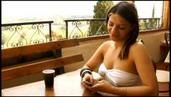 Young beautiful woman texting in italian cafe Stock Footage
