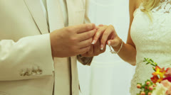 Dressing wedding rings - stock footage