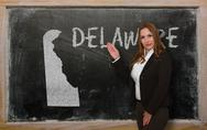 Stock Photo of teacher showing map of delaware on blackboard