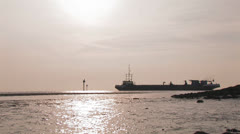 Industrial ship in sunset at sea Stock Footage