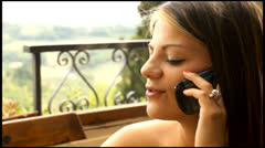 close up of beautiful young woman talking on the phone - stock footage