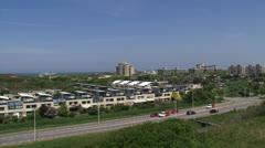 KIJKDUIN skyline city in dunes + pan dune landscape Stock Footage
