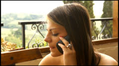 Close up of beautiful young woman talking on the phone Stock Footage