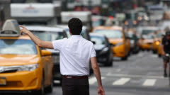 Hailing a cab taxi in New York City street Stock Footage