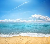 sandy beach and sea - stock photo