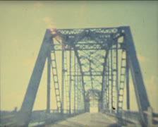 super 8 USA crossing bridges with a 1984 Mercury - stock footage