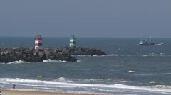 Beacons at harbour mouth - zoom out refurbished Scheveningen Boulevard Stock Footage