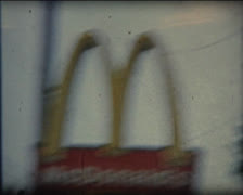 Super 8 USA crappy shot of Mc Donald restaurant sign Stock Footage