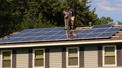 Fitting Solar Panel into place Stock Footage