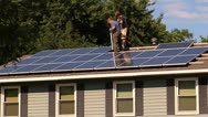 Stock Video Footage of Fitting Solar Panel into place