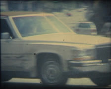 Super 8 USA 1970's cadillac car passing on the road Stock Footage