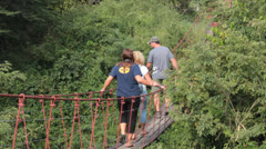 Tourists Walk over Cable Bridge Stock Footage