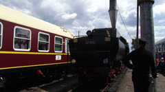 Loading steam locomotive with water at railway station Stock Footage