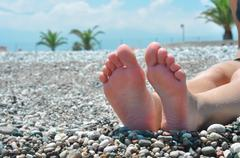 Feet on the beach Stock Photos