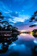 A very colorful mythical sunset over water way near ocean Stock Photos