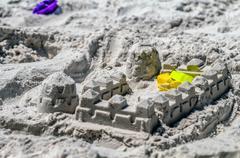 Sand castle structures built at seashore Stock Photos