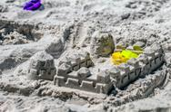 Stock Photo of sand castle structures built at seashore