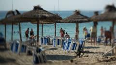 Deckchairs beach vacation travel holidays Stock Footage