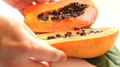 Close-up cutting half papaya Stock Footage