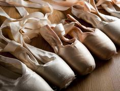 Old ballet shoes or slippers Stock Photos