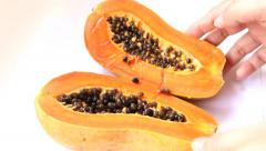 Close-up to cutting half papaya Stock Footage