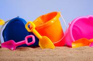 Stock Photo of row of colorful beach buckets or pails