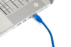 connectivity - ethernet cable in computer - stock photo