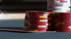 Pair of Aces under stack of chips Stock Footage