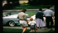 35 family gets in car, waves bye - vintage film home movie Stock Footage