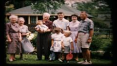 Family gathers for the camera in the backyard, 39 vintage film home movie Stock Footage